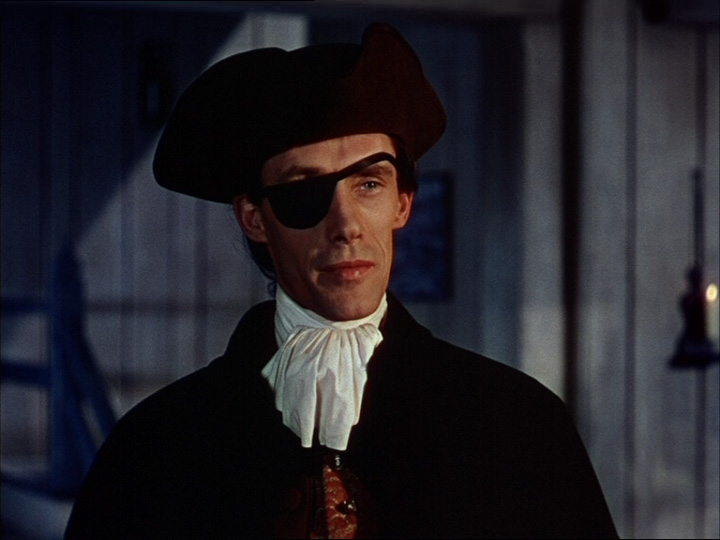 Movie screen shot of man wearing an eye patch and black hat.
