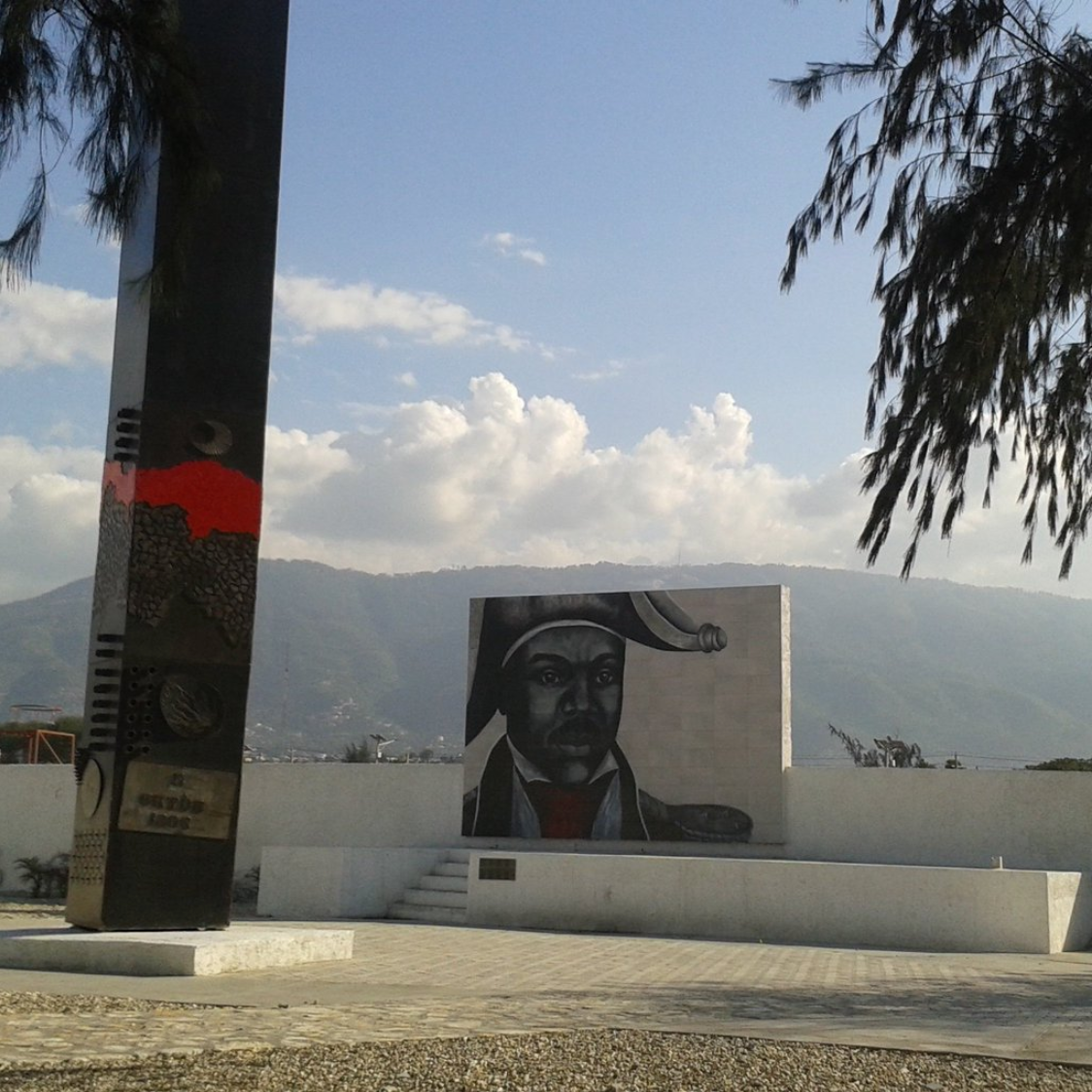 Dessalines Memorial document which features a portrait on a large wall.