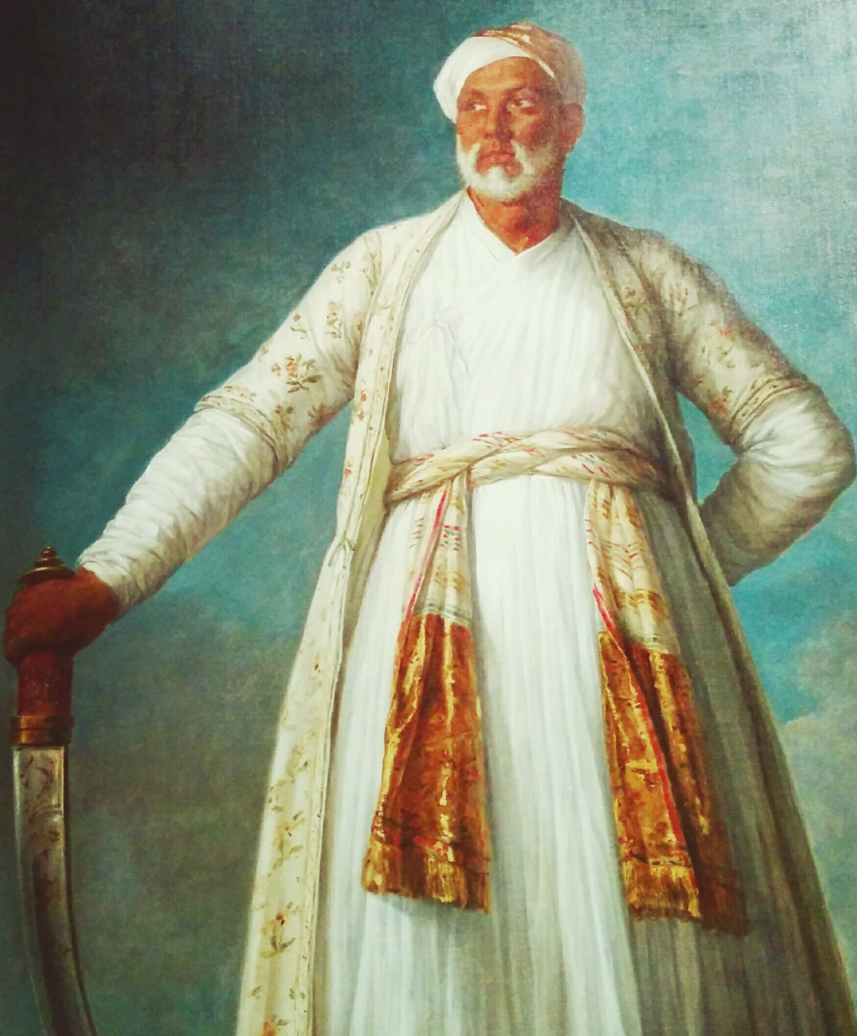 Painting of TIpu's ambassador to France, wearing white robes.