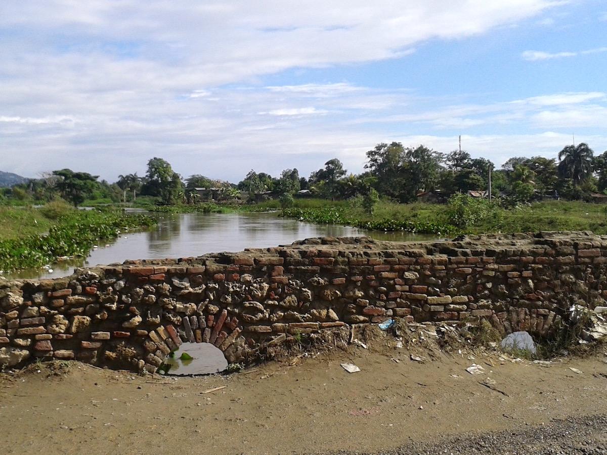 Colonial-era brick bridge over a river.