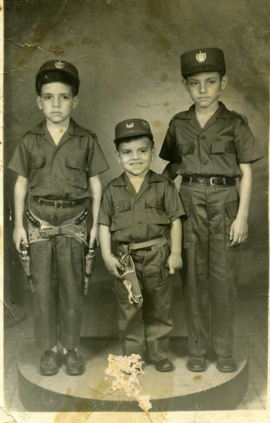 Photograph of Jorge, Tony, and Enrique Ermus wearing uniforms.