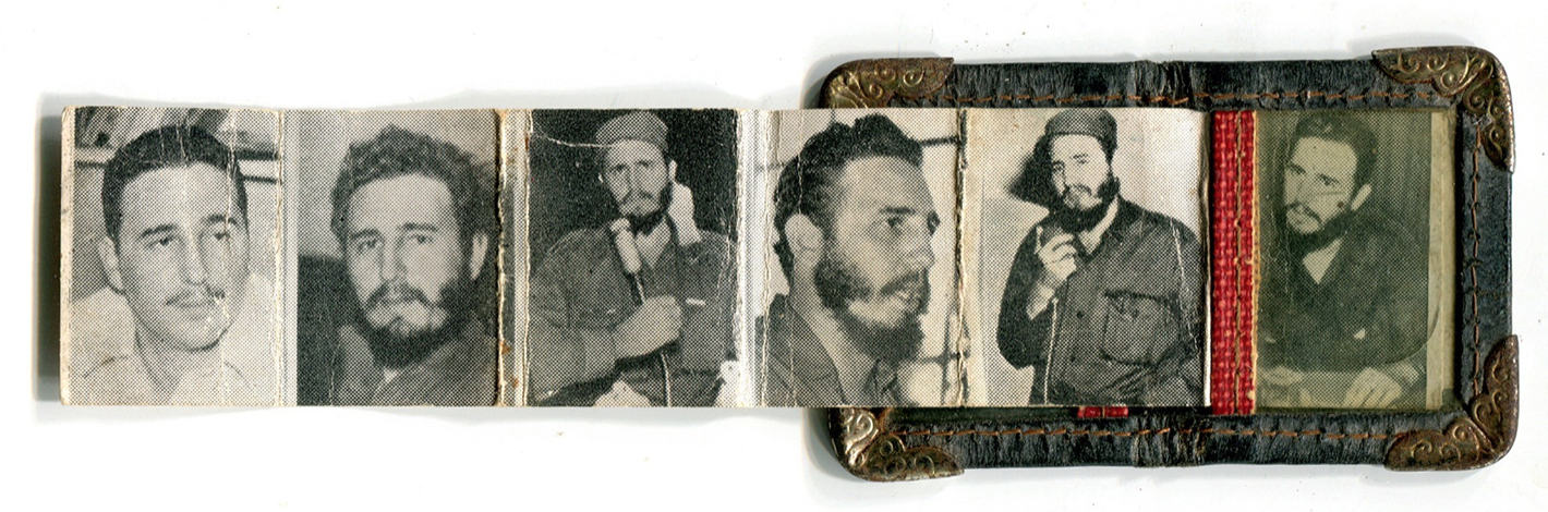 Accordion foldout keepsake with Castro portraits.
