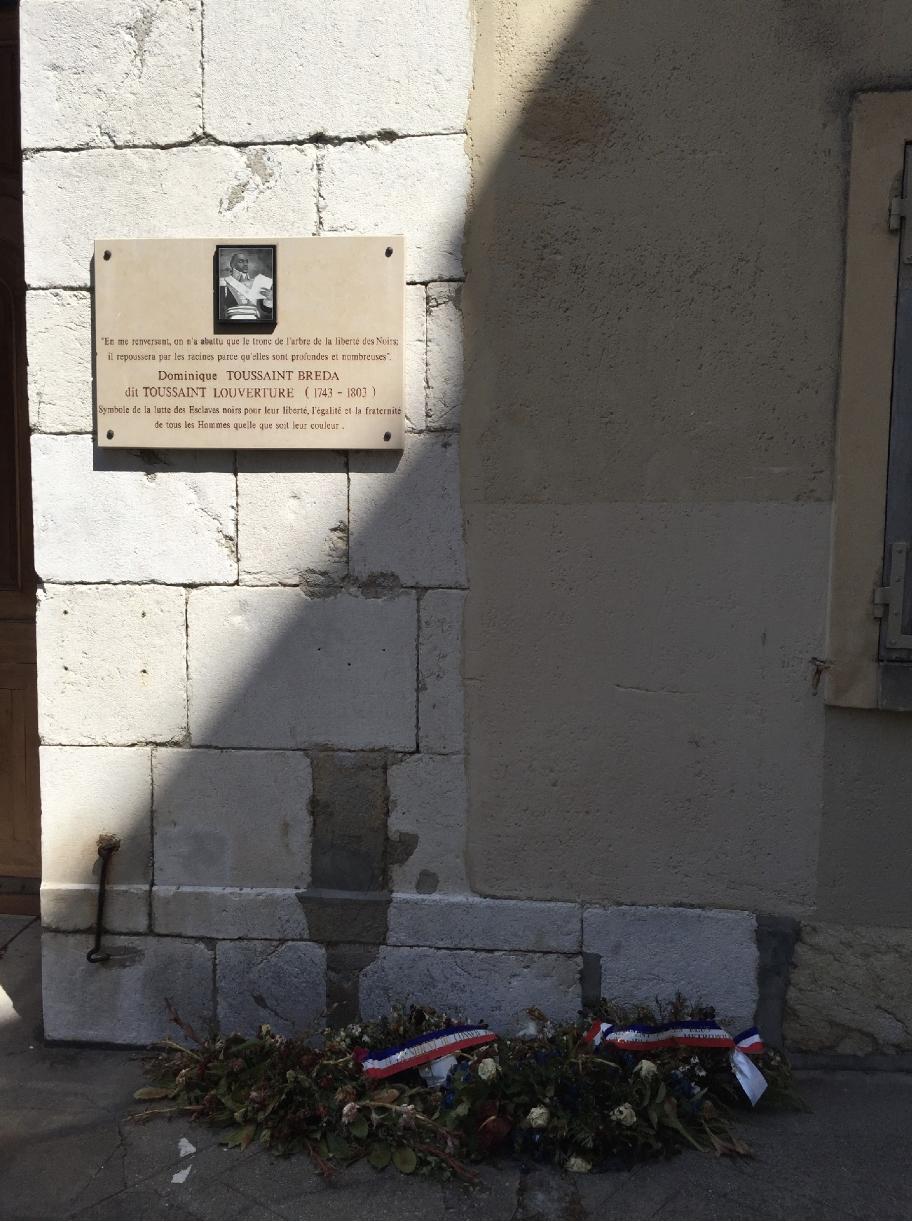 A commemorative plaque to Toussaint L'ouverture.