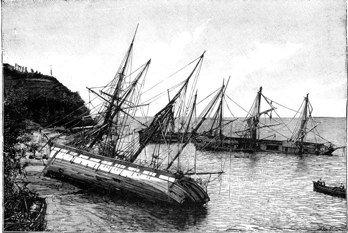 Boats run aground a beach in Martinique.