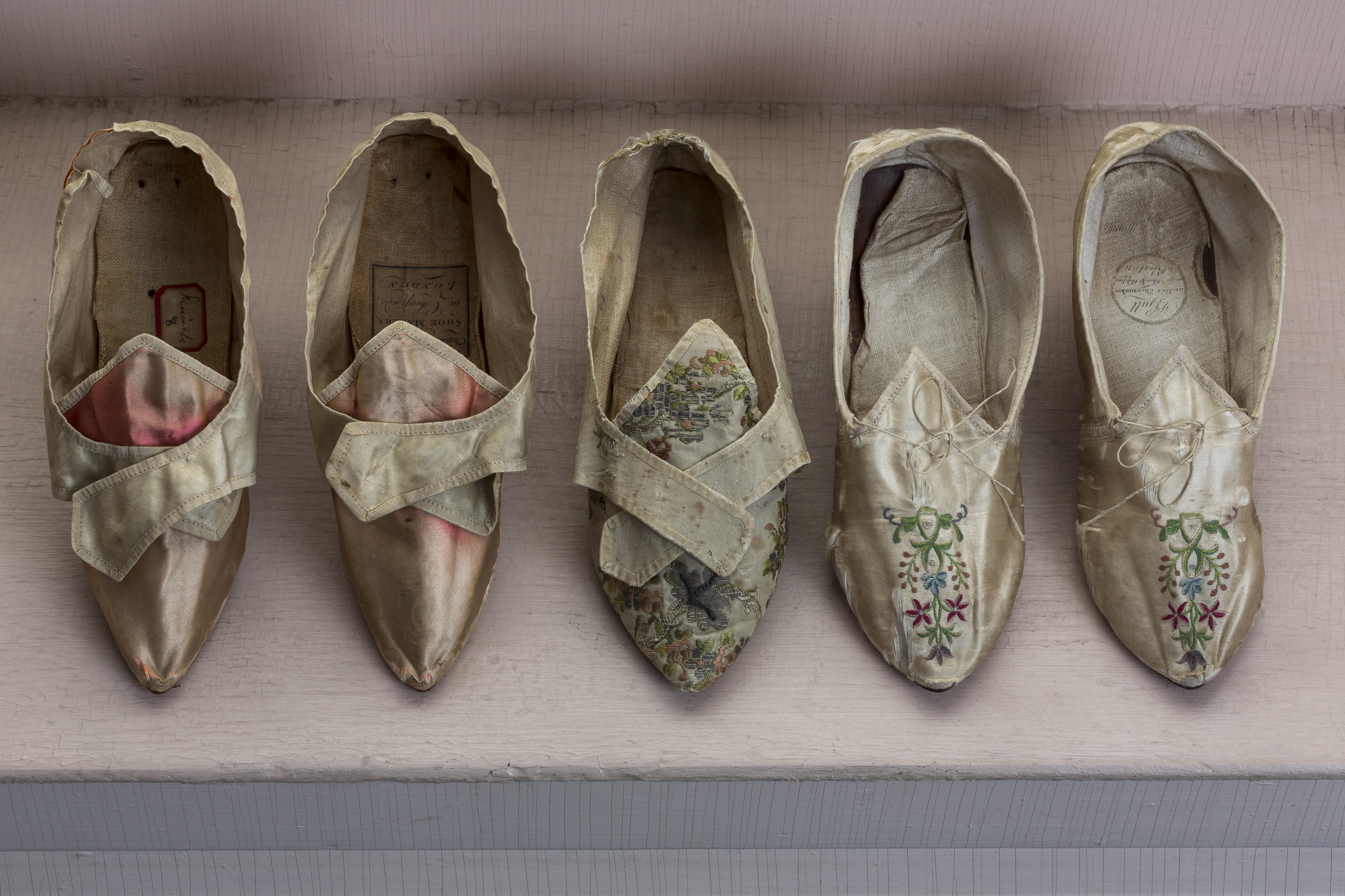 Five women's shoes from the 1780s.