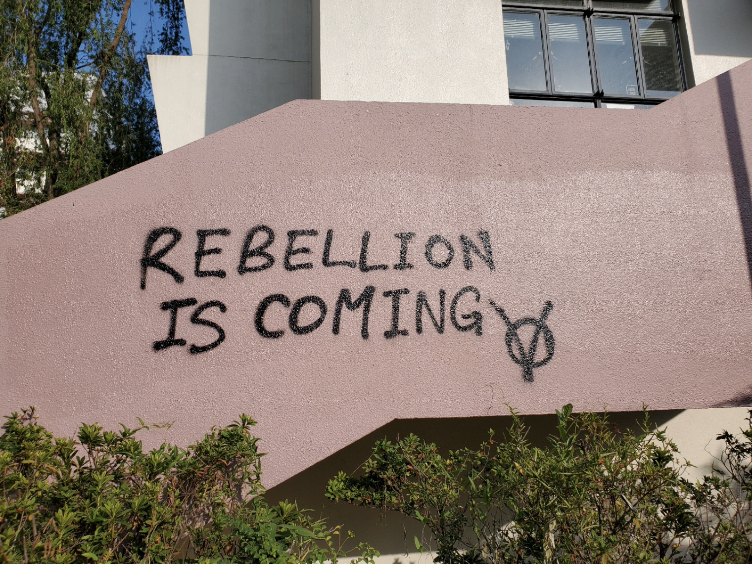 "Graffiti that reads ""Rebellion is coming"" on the CUHK campus."